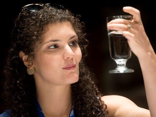 News Sentinel reporter Brittany Crocker looks at a glass of tap water during Tennessee's Best Tasting Water Contest on Thursday, Aug. 9, 2018, during the Tennessee Association of Utility Districts' business conference at the Gatlinburg Convention Center.