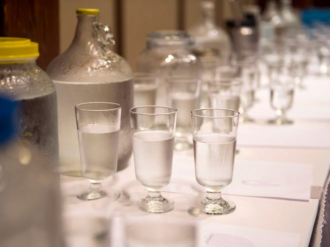 Glasses of tap water taken from across Tennessee wait to be judged at Tennessee's Best Tasting Water Contest on Thursday, Aug. 9, 2018, during the Tennessee Association of Utility Districts' business conference at the Gatlinburg Convention Center.