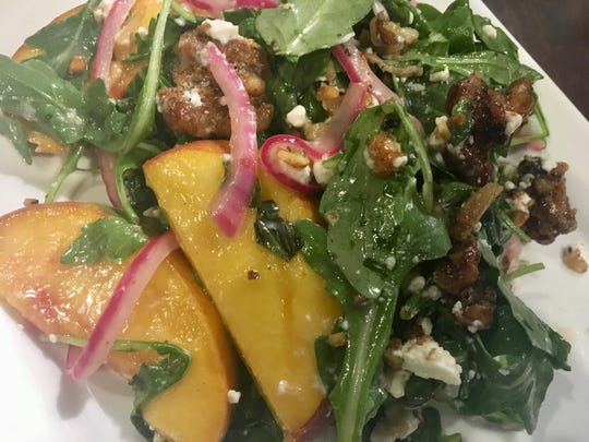 Candied peach salad prepared by Chef Bruce Bogartz for Water into Wine Restaurant