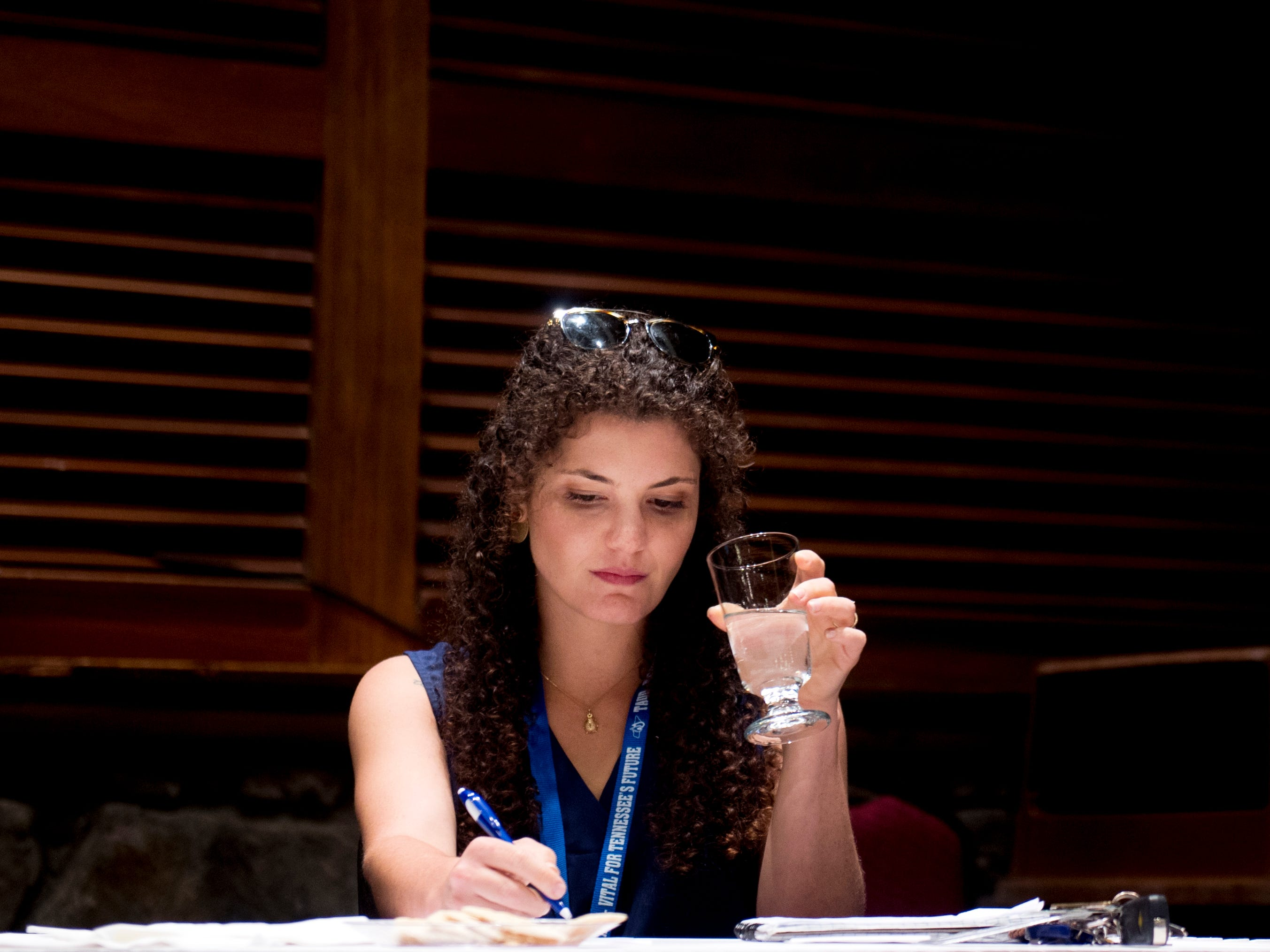 News Sentinel reporter Brittany Crocker scores a glass of tap water during Tennessee's Best Tasting Water Contest on Thursday, Aug. 9, 2018, during the Tennessee Association of Utility Districts' business conference at the Gatlinburg Convention Center.
