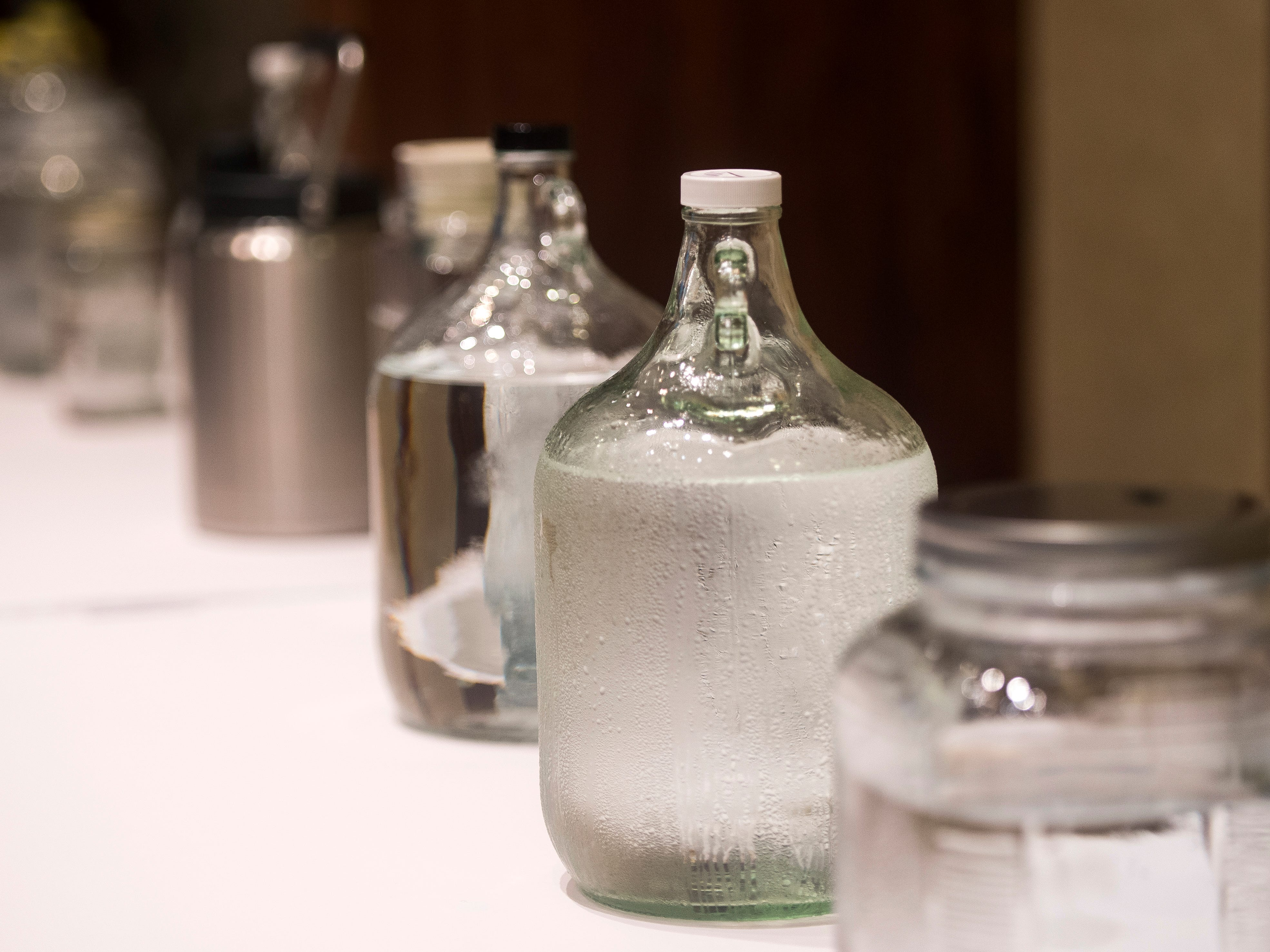 Containers holding tap water from across the state are lined up on a table at Tennessee's Best Tasting Water Contest held on Thursday, August 9, 2018, during the Tennessee Association of Utility Districts' business conference held at the Gatlinburg Convention Center.