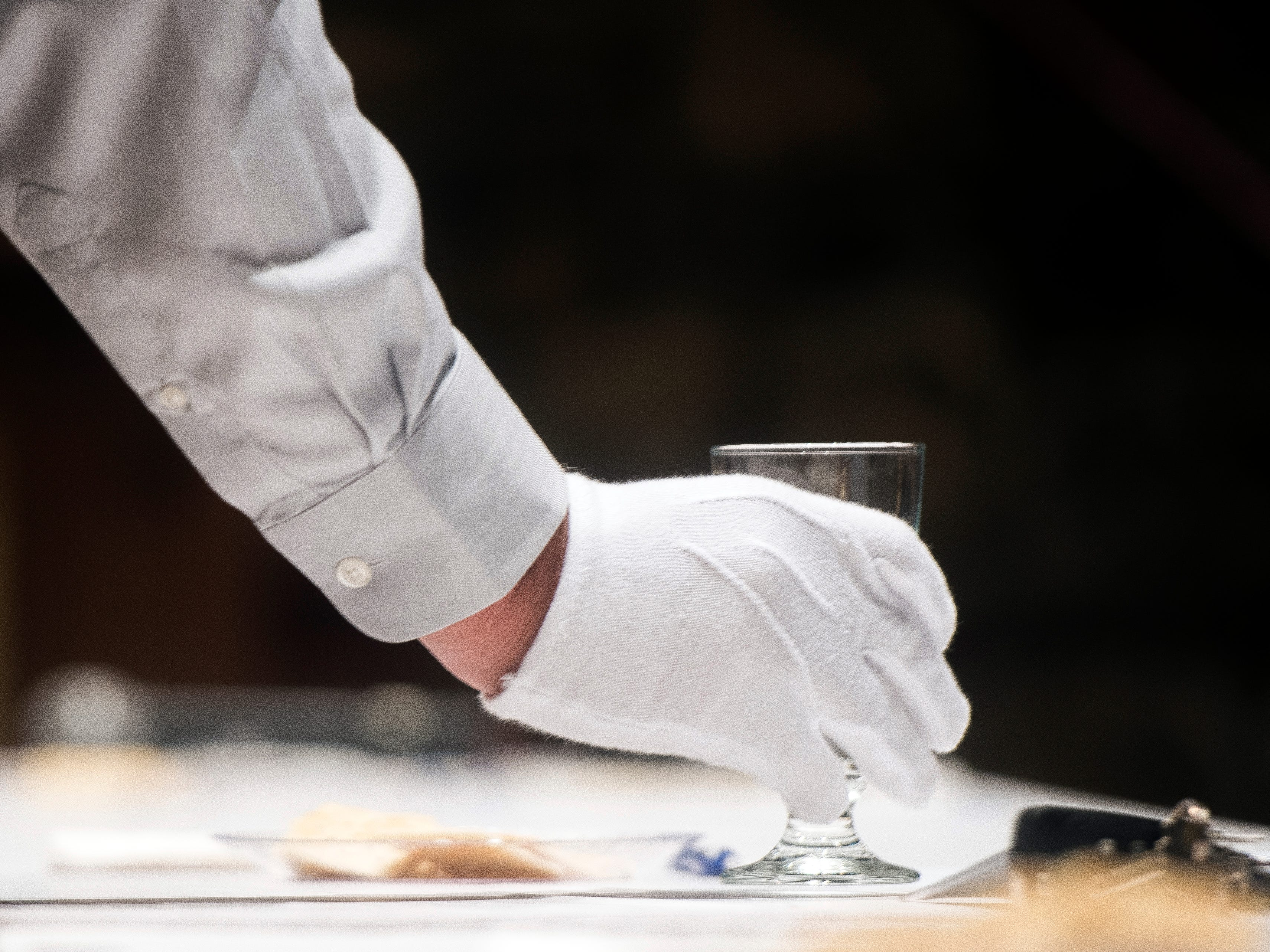 White gloves are worn as glasses of tap water are given to judges at Tennessee's Best Tasting Water Contest on Thursday, Aug. 9, 2018, during the Tennessee Association of Utility Districts' business conference at the Gatlinburg Convention Center.