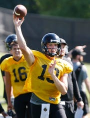 Quarterback Jack Plummer with a pass during Purdue football practice Thursday, August 9, 2018, in West Lafayette.