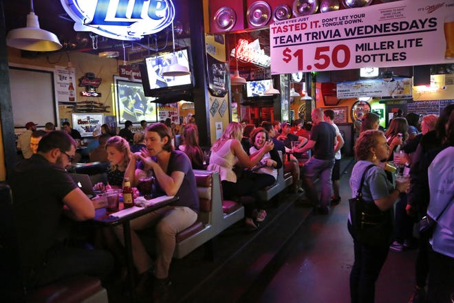 A crowd packs Jake's Roadhouse in West Lafayette on April 9, 2015. The bar announced it had closed it's doors for good on Wednesday evening after a rough summer of business.