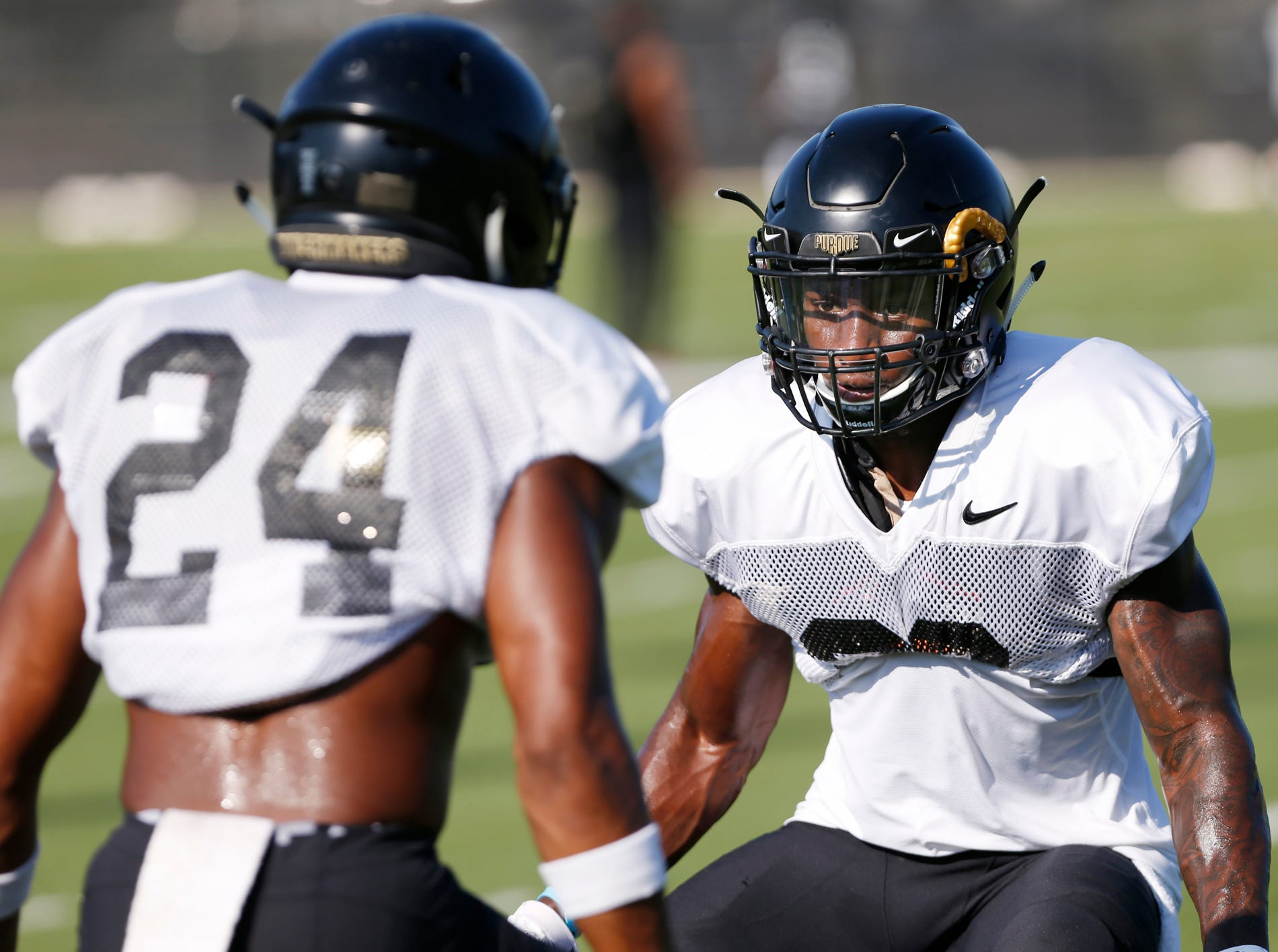 Cornerback Kenneth Major, right, matches up opposite fellow cornerback Tim Cason in a drill during Purdue football practice Thursday, August 9, 2018, in West Lafayette.