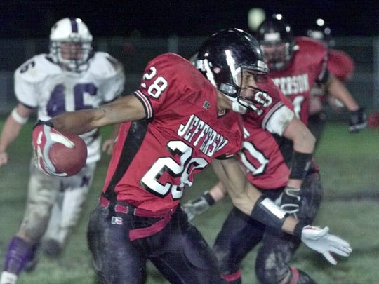 Lafayette Jeff's Dustin Keller looks for running room after a reception against Muncie Central at Lafayette on Friday October 5, 2002.