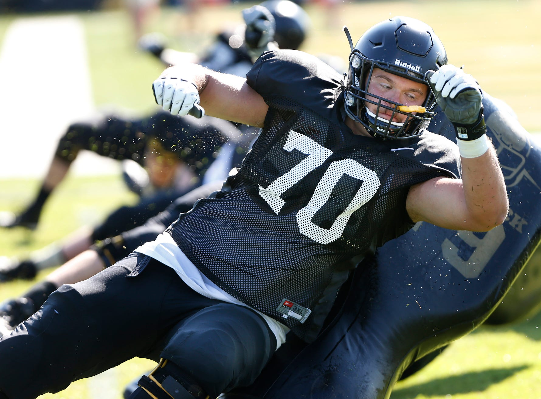 Offensive lineman Will Bramel during a blocking drill at Purdue football practice Thursday, August 9, 2018, in West Lafayette.