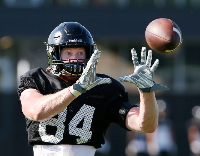Tight end Jess Trussell with a catch during Purdue football practice Thursday, August 9, 2018, in West Lafayette.