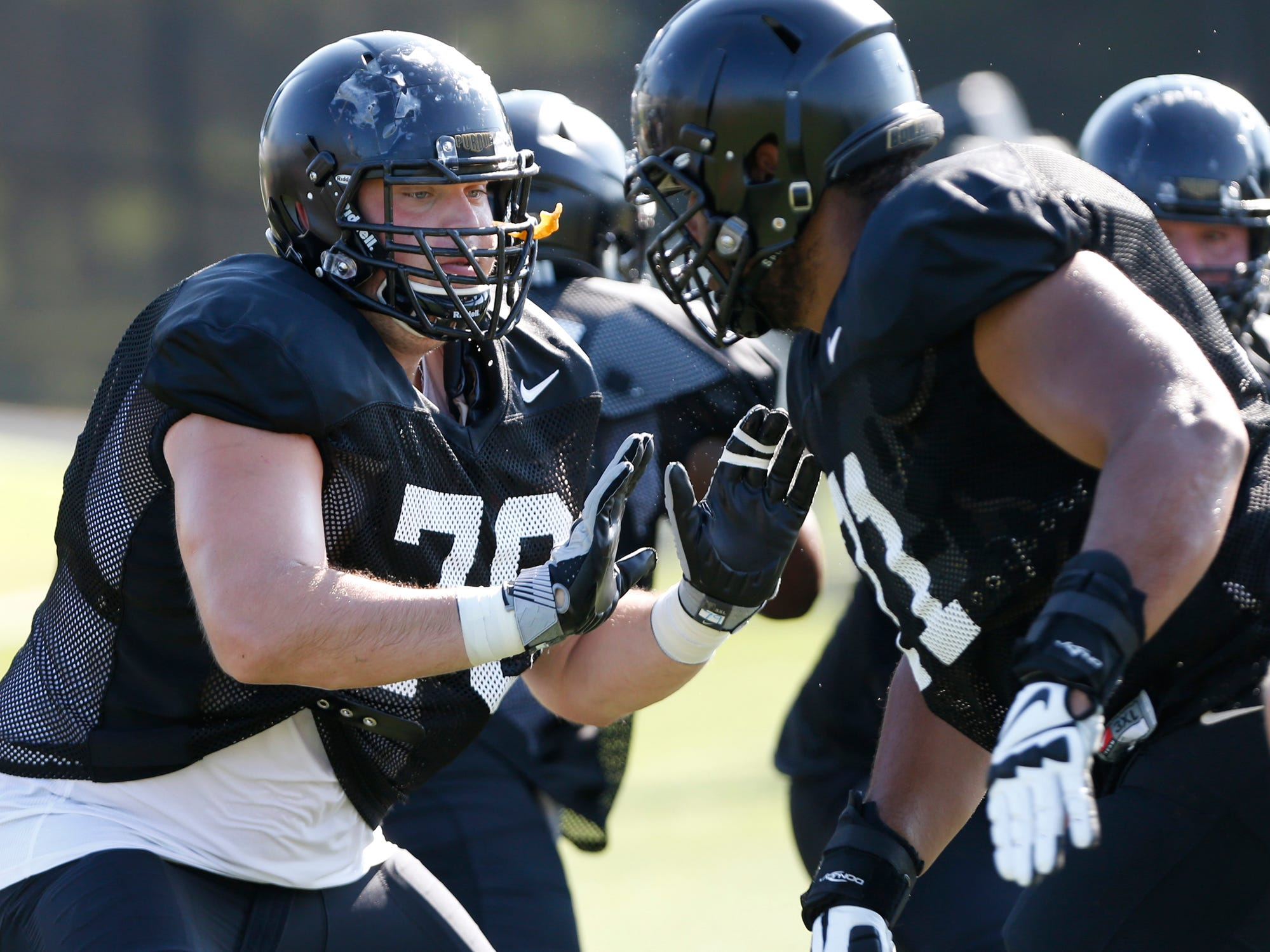 Offensive lineman Mark Stickford, left, blocks fellow offensive lineman Sam Loebig during Purdue football practice Thursday, August 9, 2018, in West Lafayette.