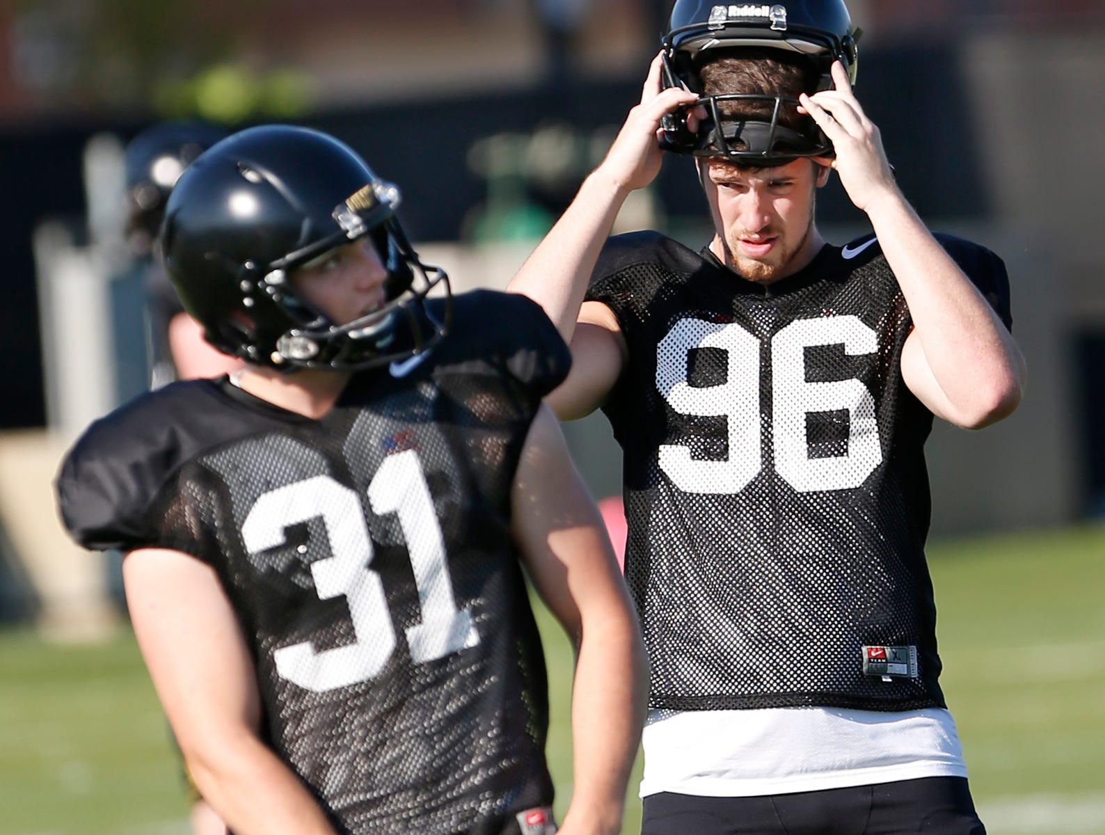 Punters Joe Schopper, left, and Jake Herr during Purdue football practice Thursday, August 9, 2018, in West Lafayette.