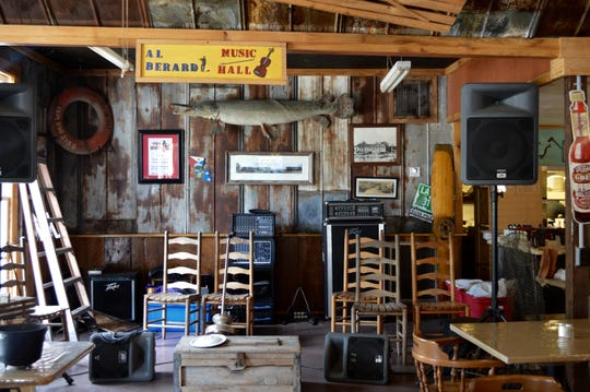 The music stage at Old Courtableau Café is likened to that of a houseboat deck and was named in honor of Al Berard.