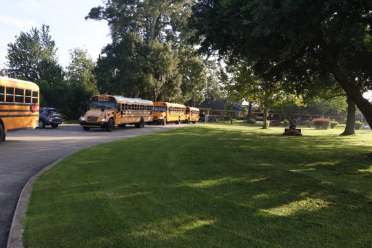 School buses line up at L.J. Alleman Middle in August 2017.