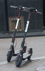 Bird dockless scooters at Fourth Street Live.  The company is promoting the use of the scooters to coincide with a 30-day permit agreement with the city of Louisville.Aug. 9, 2018