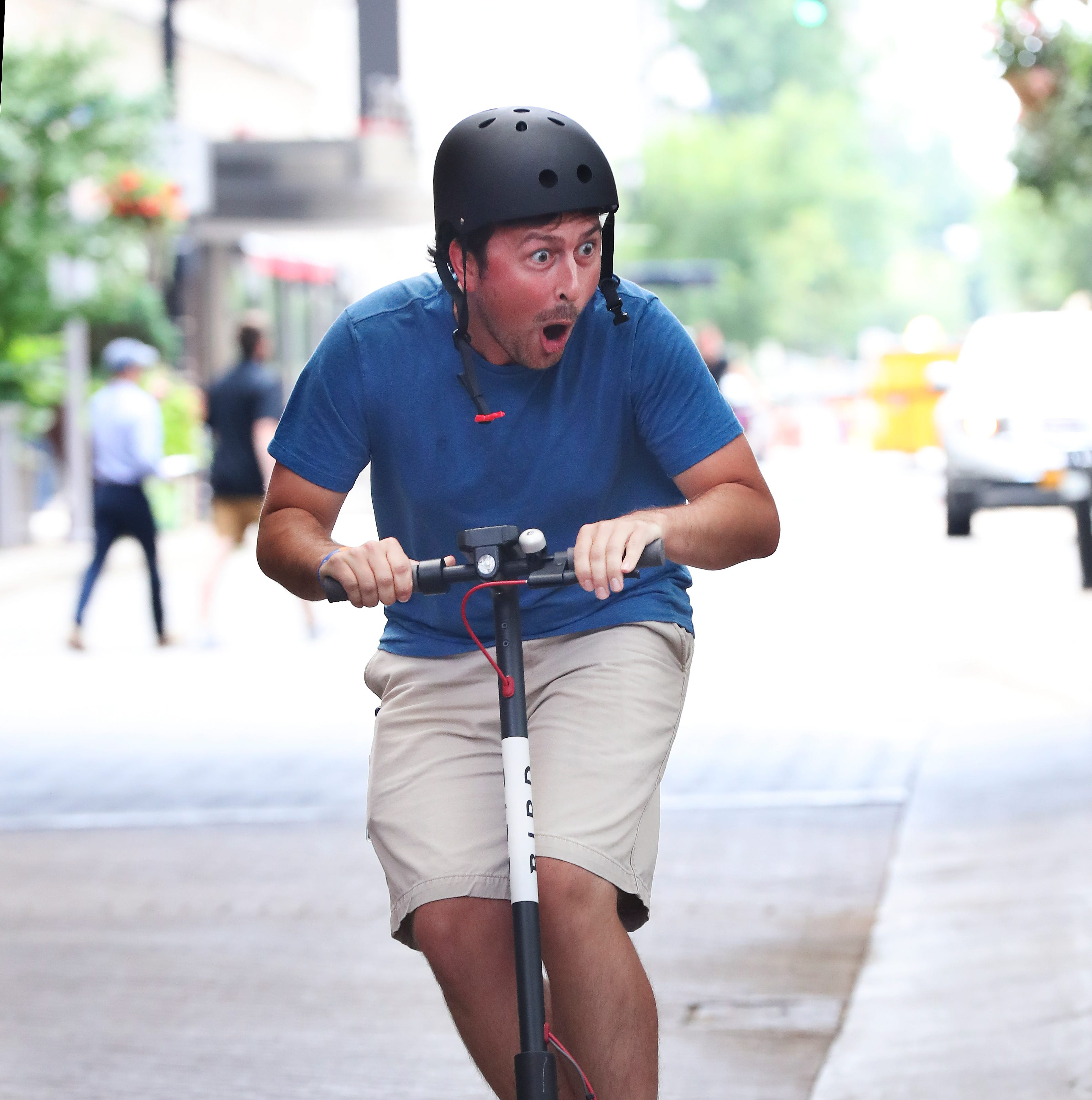 Toy or transport? Here's what people think of the dockless Bird scooters