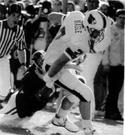 File photo: Louisville quarterback Browning Nagle during the 1991 win over Alabama in the Fiesta Bowl. James Wallace photo.