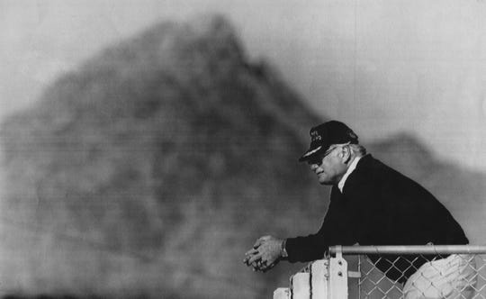 Against a mountainous backdrop, U of L football coach Howard Schnellenberger watched his team practice in preparation for their Fiesta Bowl appearance against Alabama, in Arizona. Dec 30, 1990