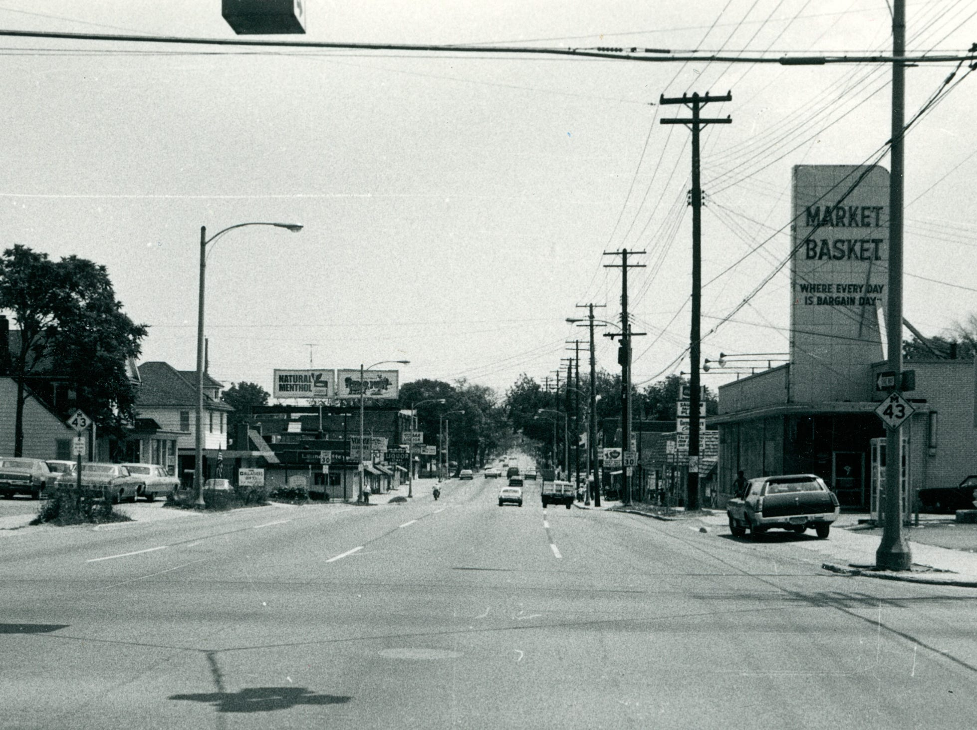 Market Basket, Celentino's Lounge and other businesses on Saginaw Street, date unknown.