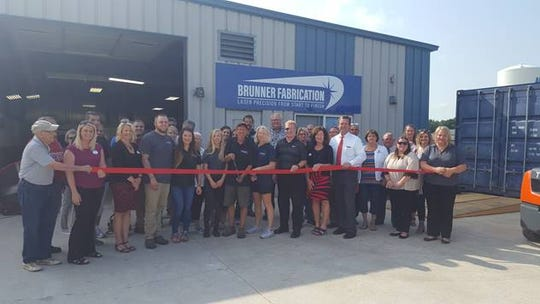 Assisting Brunner Fabrication owners Chris and Tracy Brunner with a ribbon-cutting Aug. 6 were Vice President of Operations Matt Brunner and his wife Tera, their families, Manitowoc Mayor Justin Nickels, Chamber Executive Director Karen Nichols, members of the Chamber's Board of Directors, Chamber Ambassadors, and many friends from the community.
