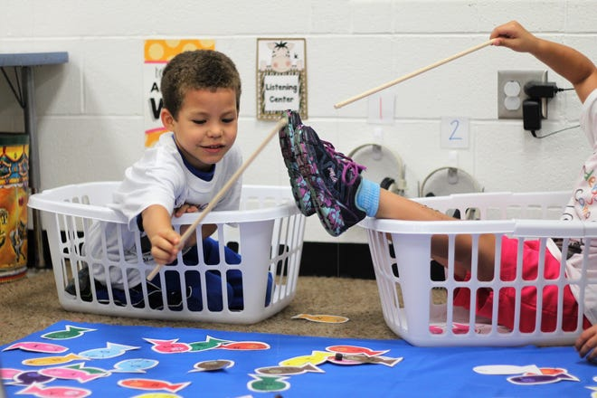 Quincee McCants fishes for letters at Taft Elementary on Wednesday. He is enrolled in a camp that aims to prepare incoming students for kindergarten.