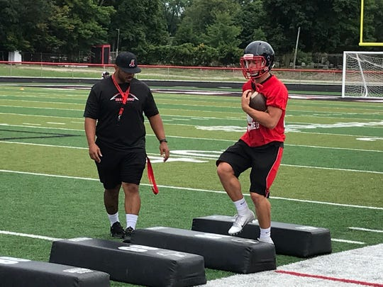 New Marion Harding head football coach Jerrod Slater oversees a running back drill during the first day of preseason practice. Slater was a former standout running back and nose guard for the Presidents.