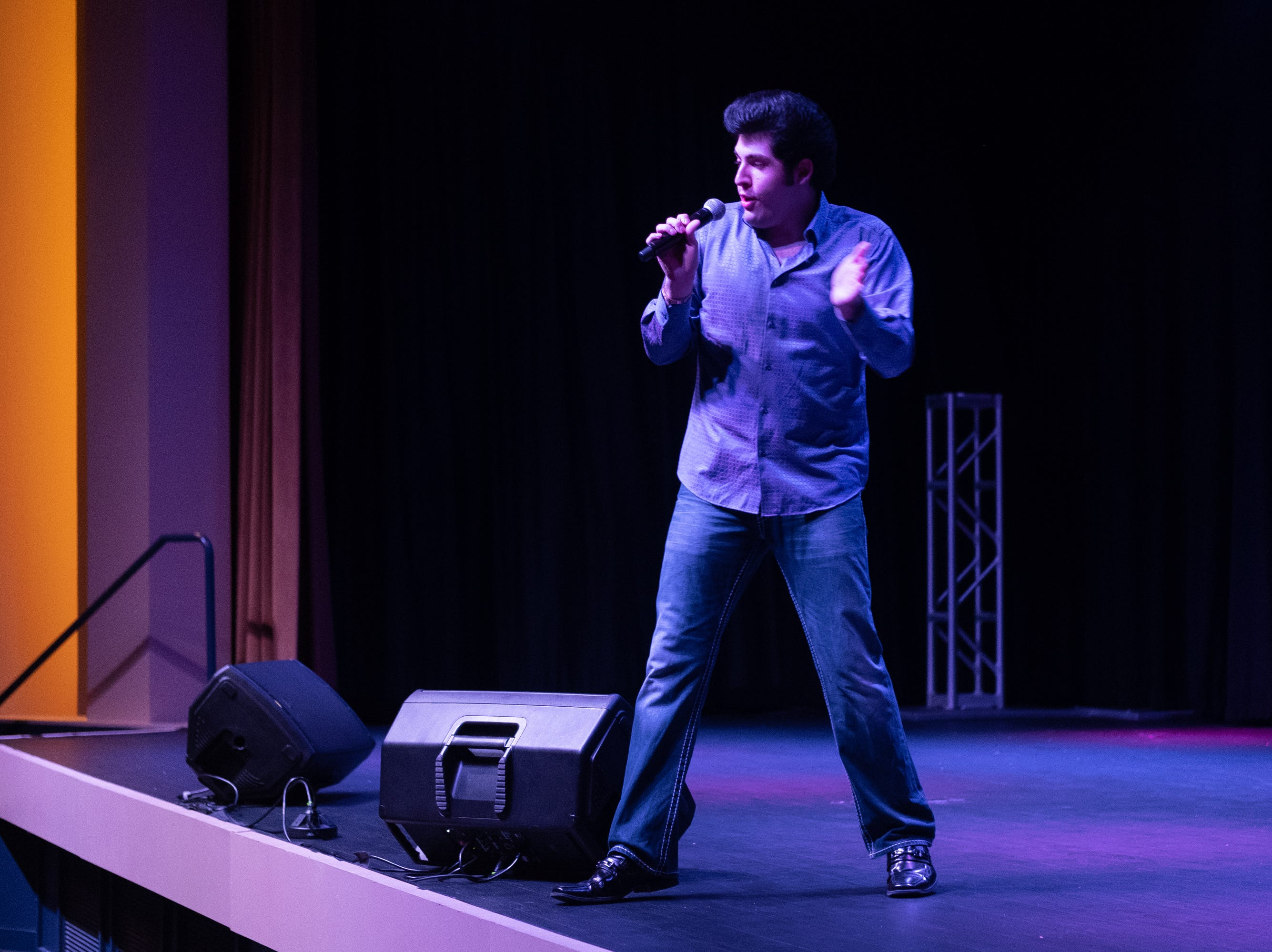 """Austin Irby dances while singing """"Spin Out."""" He won the Georgia Elvis Festival."""