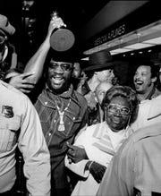 Isaac Hayes, returning to Memphis in 1972 after his Oscar win accompanied by his grandmother Rushia Wade.