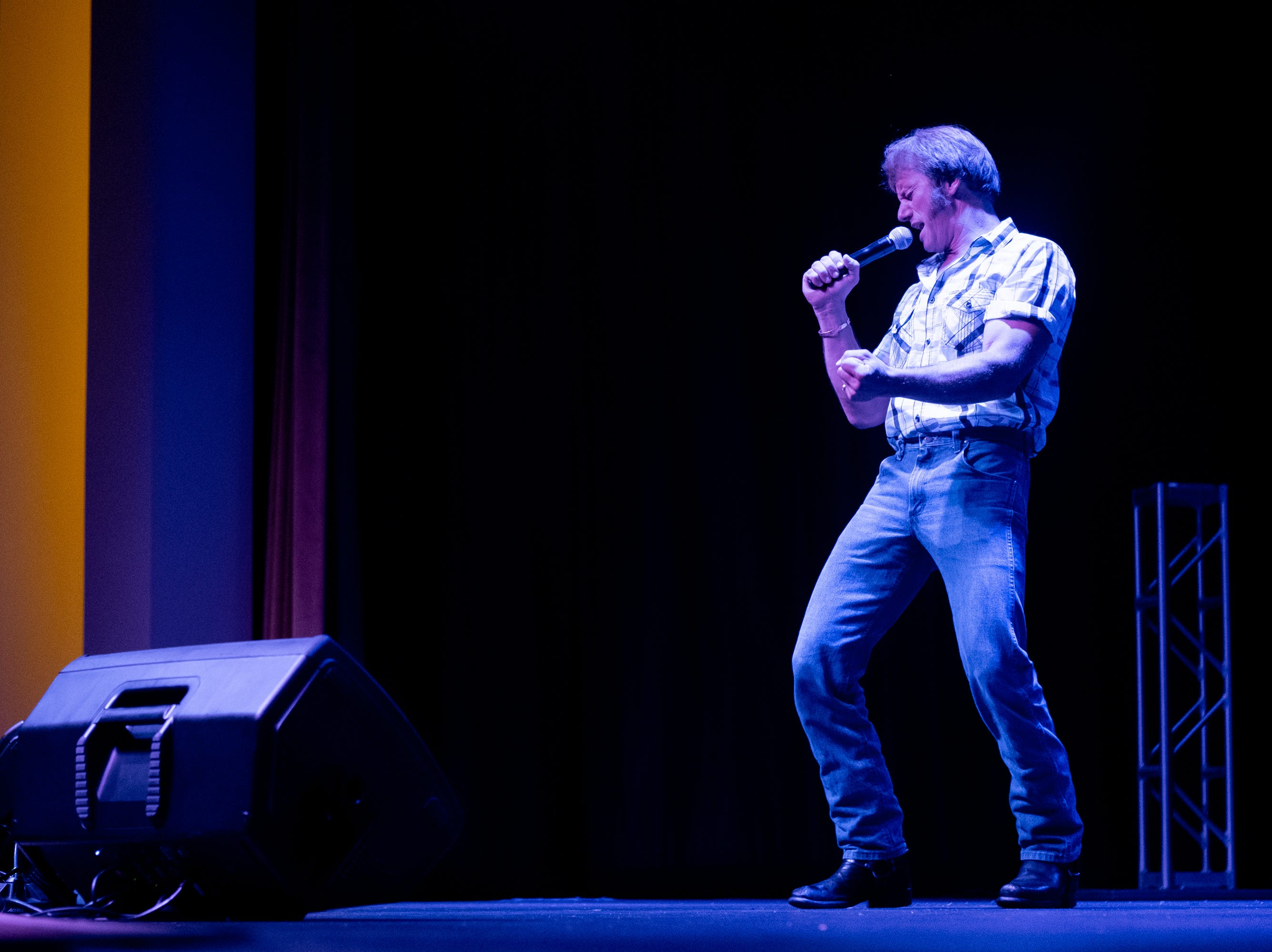 """Steve Sogura, winner of the Penticon Elvis Festival, performs """"Let Me Be There"""" at Graceland's Guest House theater on Thursday afternoon."""