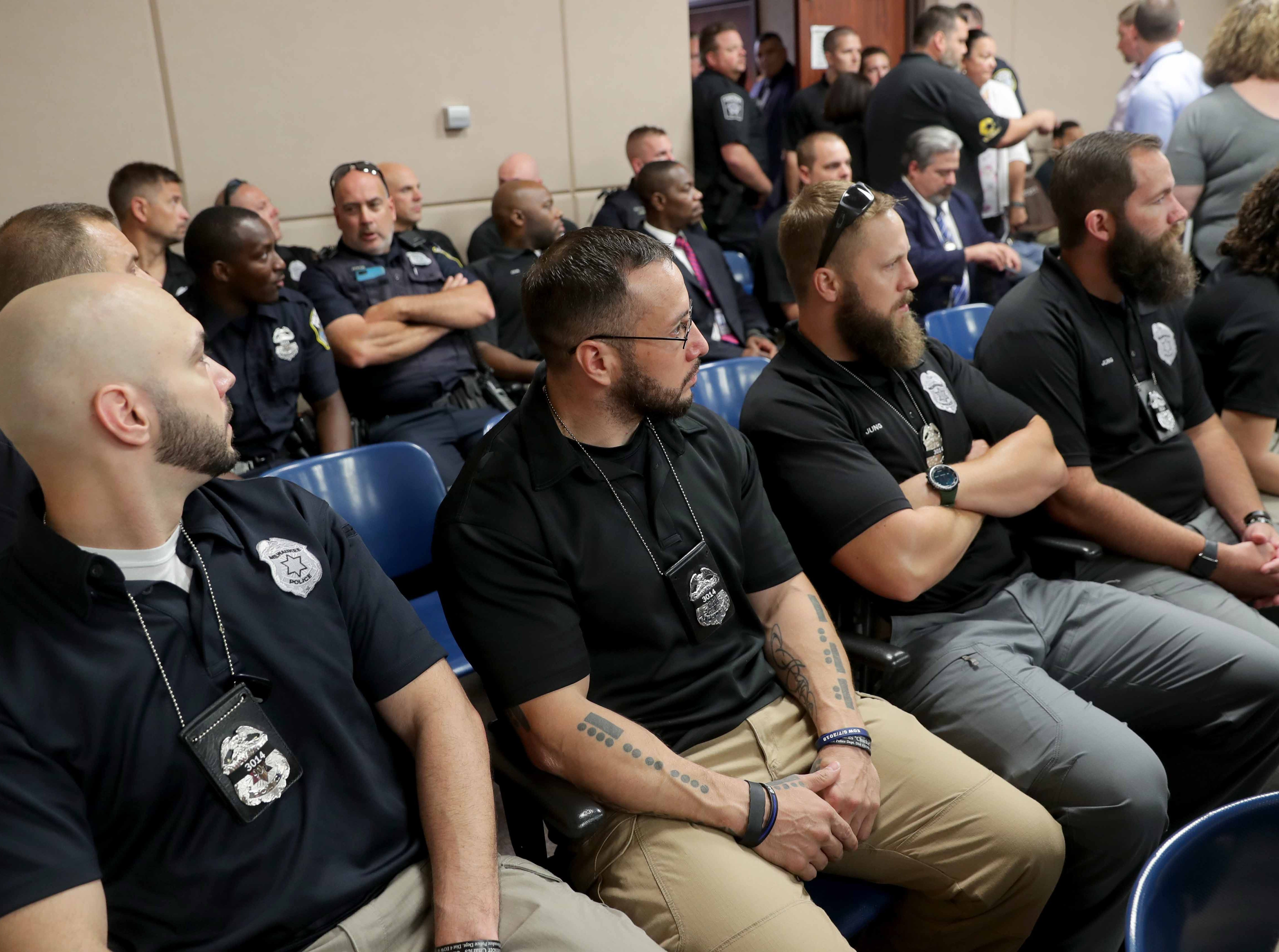 Members of the Milwaukee Police Department gather in court for the appearance of Jonathan Copeland Jr., 30, who is charged in the fatal shooting of Milwaukee Police Officer Michael Michalski.