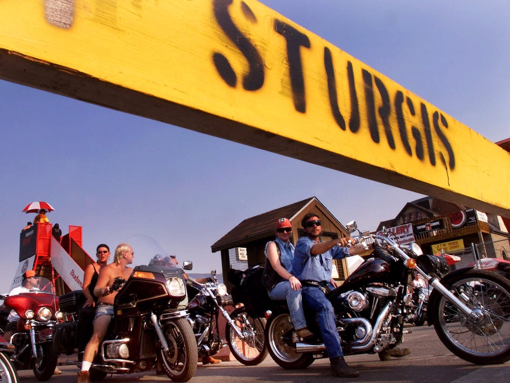 2000: Motorcycle riders ease their way along Main Street in Sturgis, S.D., on Aug. 8, 2000, for the second day of the Sturgis Motorcycle Rally. Hundreds of thousands of riders were expected in the Black Hills area for the 60th annual rally.