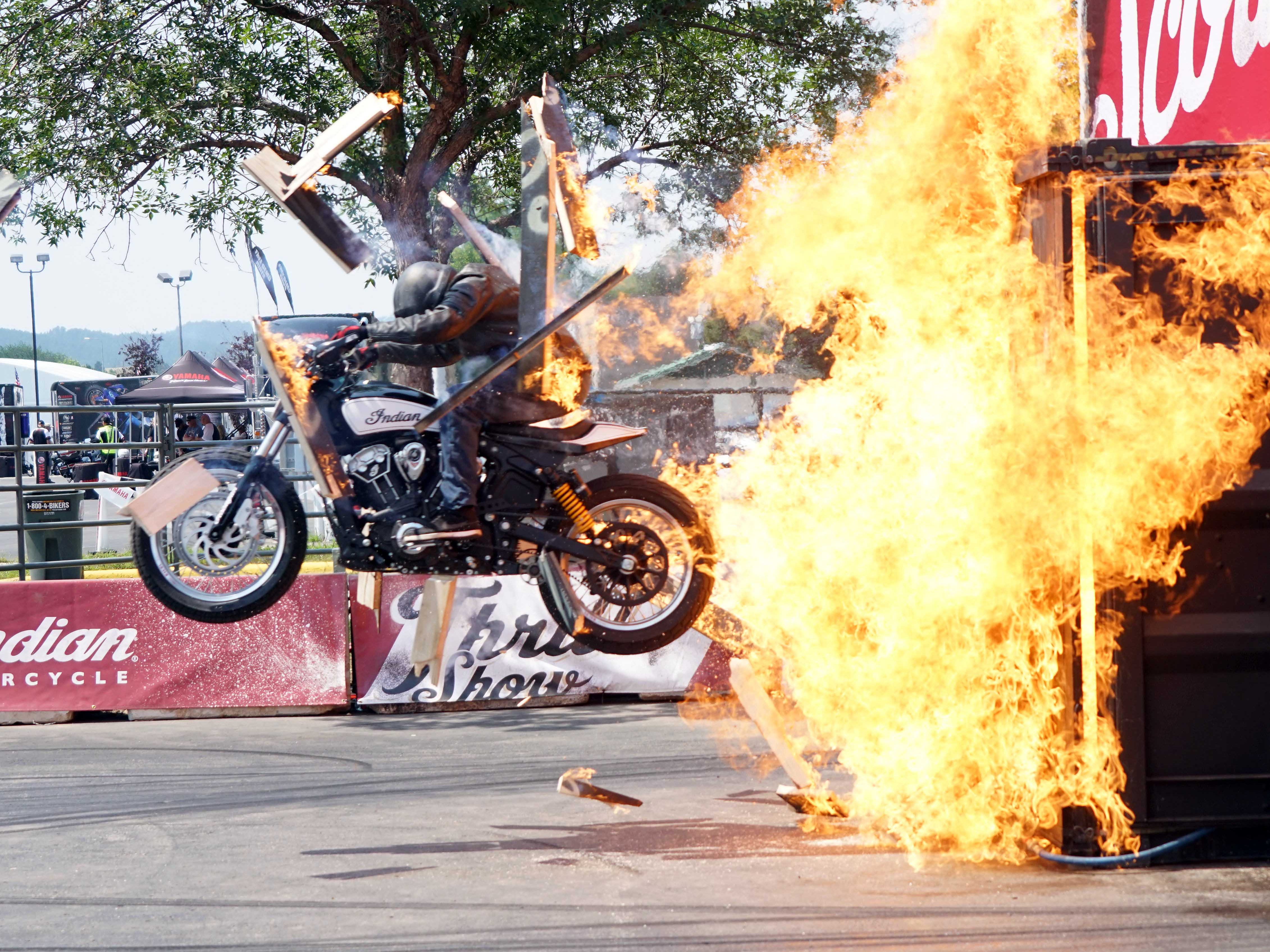 2018: A stunt rider with the Indian Motorcycle team launches off a jump during a demonstration during the  Sturgis rally.