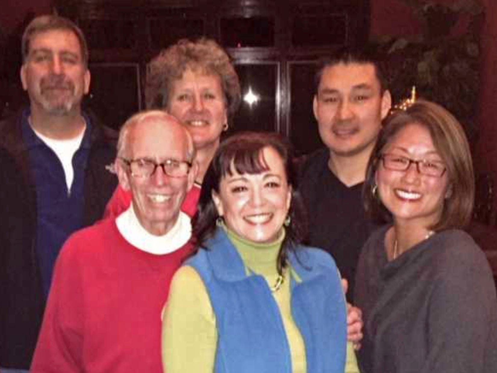 A family photo shows Tom Peters and his daughter Mary Jane Millehan in front, along with Mary Jane's husband, Ron, and three of Tom's adopted children, Terri, Gary and Karen.