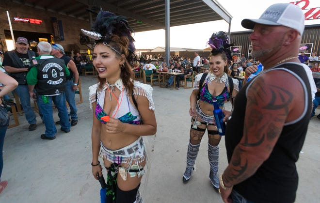 Women dressed as unicorns sell shots at the Full Throttle Saloon in Vale, S.D.