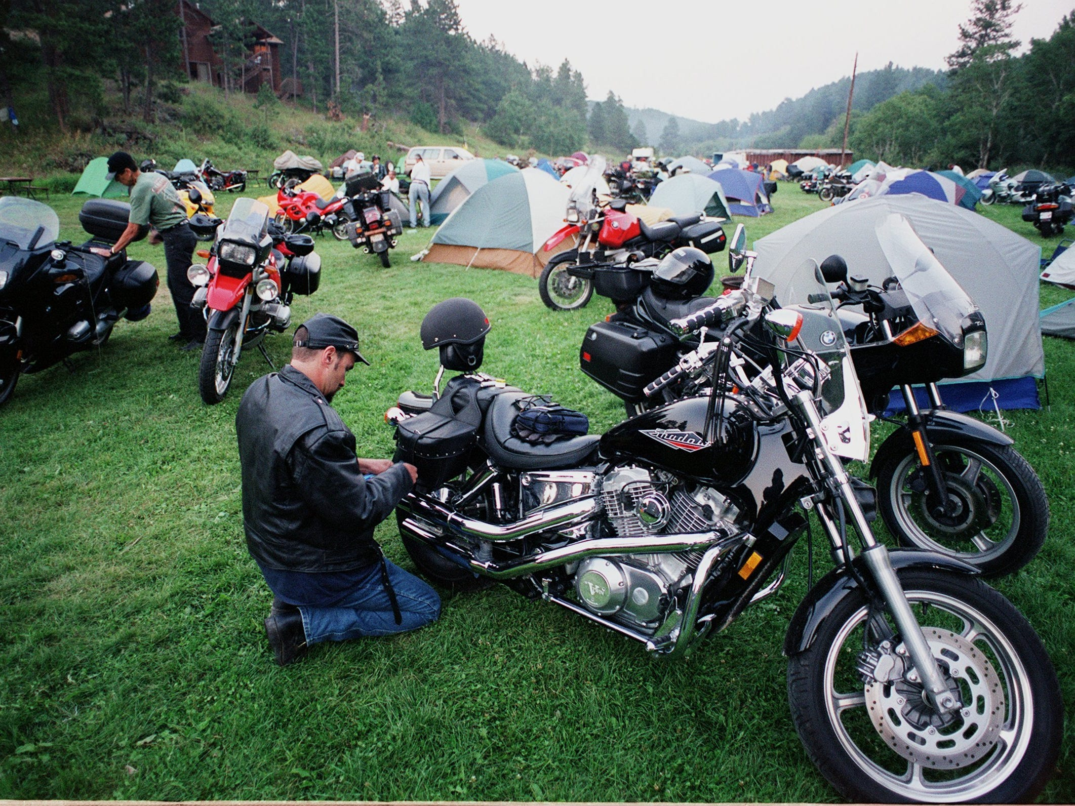 2000: Motorcyclists get ready to leave the Whispering Spring Campground  near Silver City, S.D., in the heart of the Black HIlls in August 2000.
