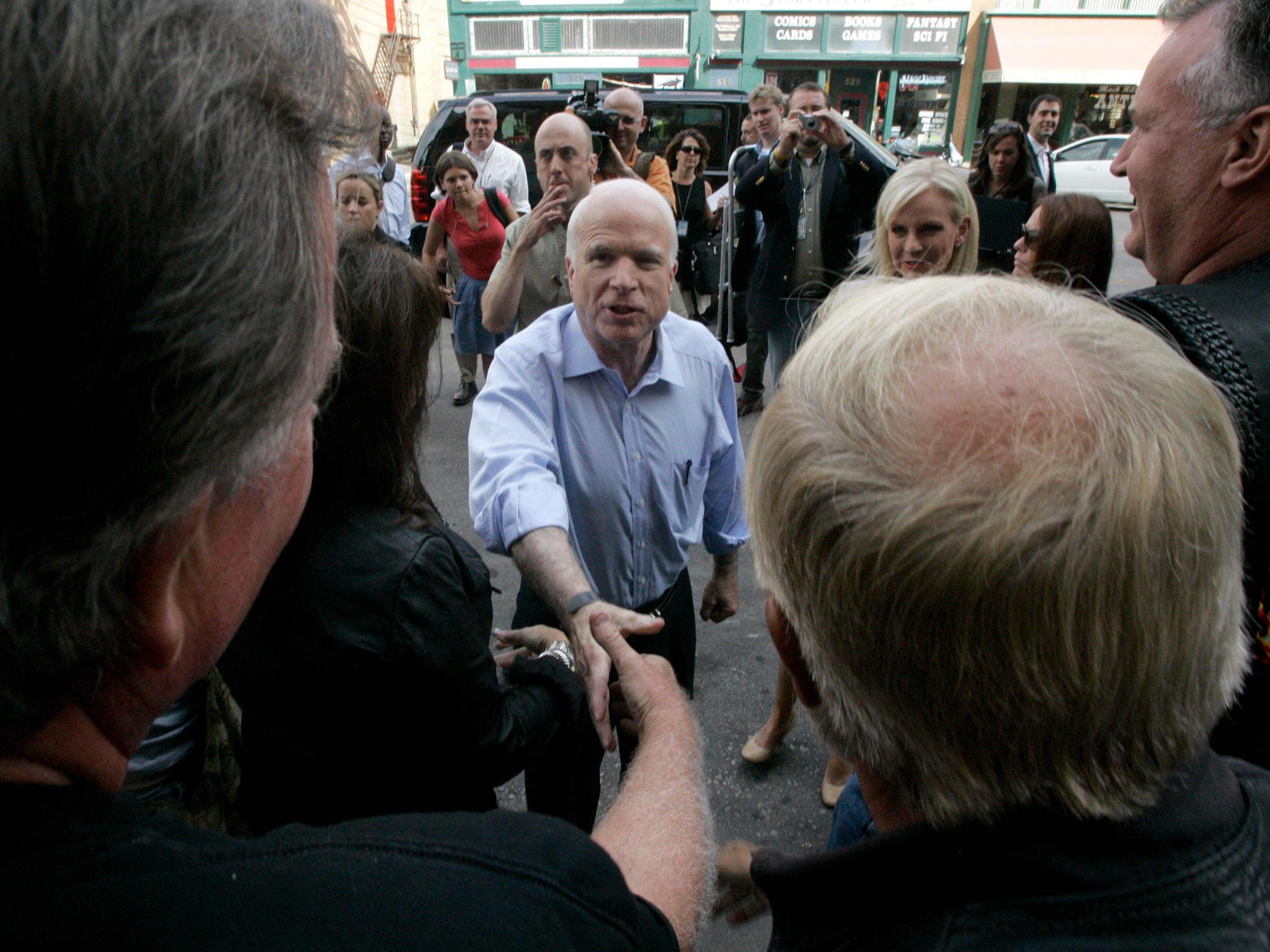 2008: Republican presidential candidate Sen. John McCain, R-Ariz., greets the crowd in Rapid City, S.D. McCain also planned to visit the annual motorcycle rally in Sturgis.