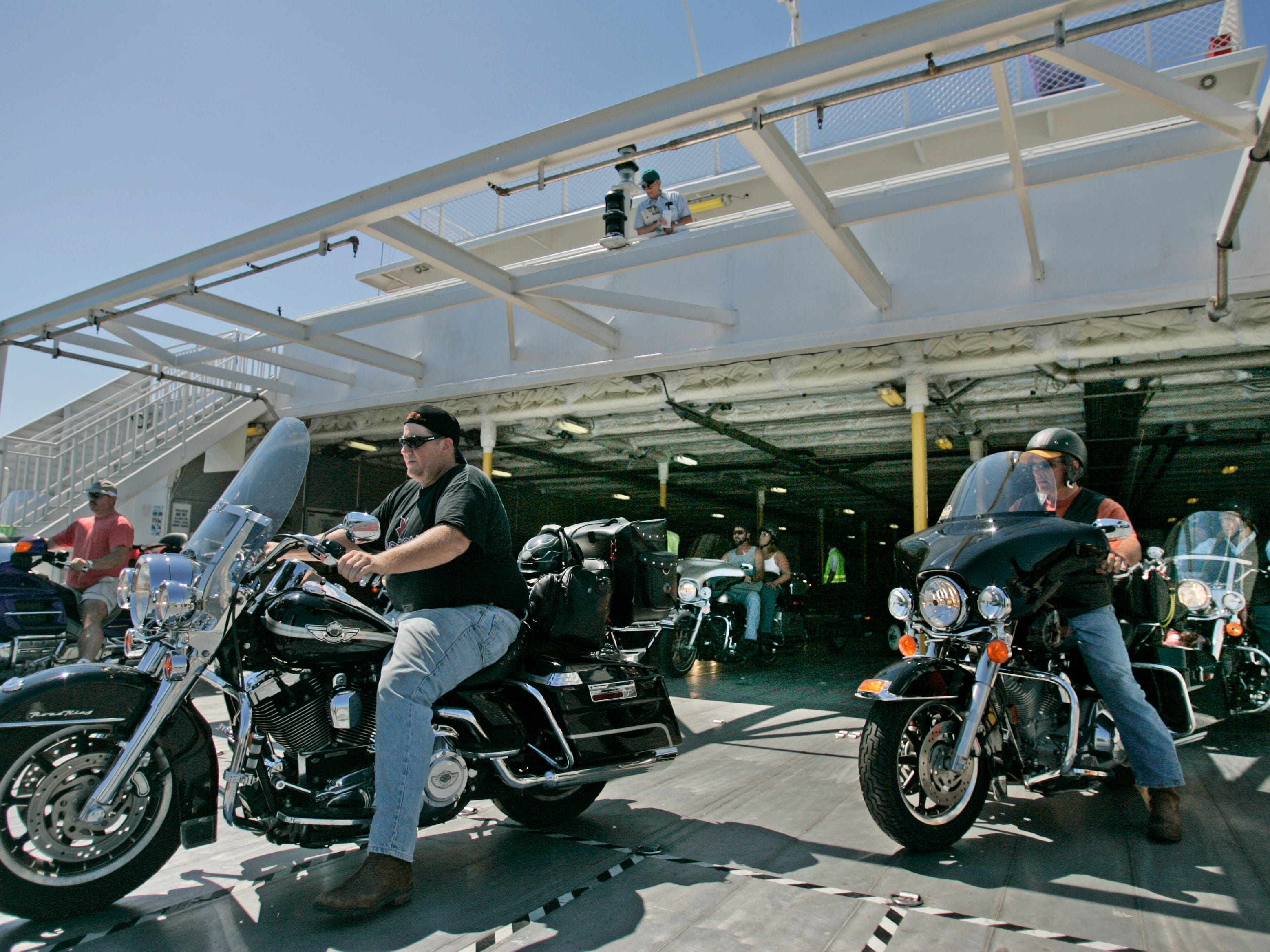 2005: Passengers on the the Lake Express Ferry in Milwaukee watch as 32 motorcycles roar off the ferry after making the trip from Muskegon, Mich.,  en route to the 65th annual Sturgis Motorcycle Rally in Sturgis, S.D. The ferry has become popular with motorcyclist looking for a quick way  around Chicago.