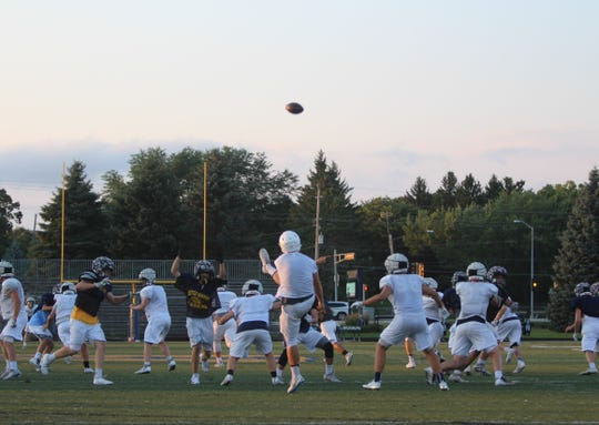 A punt from Kettle Moraine's Blake Wilcox sails into the sky during a practice on August 6.