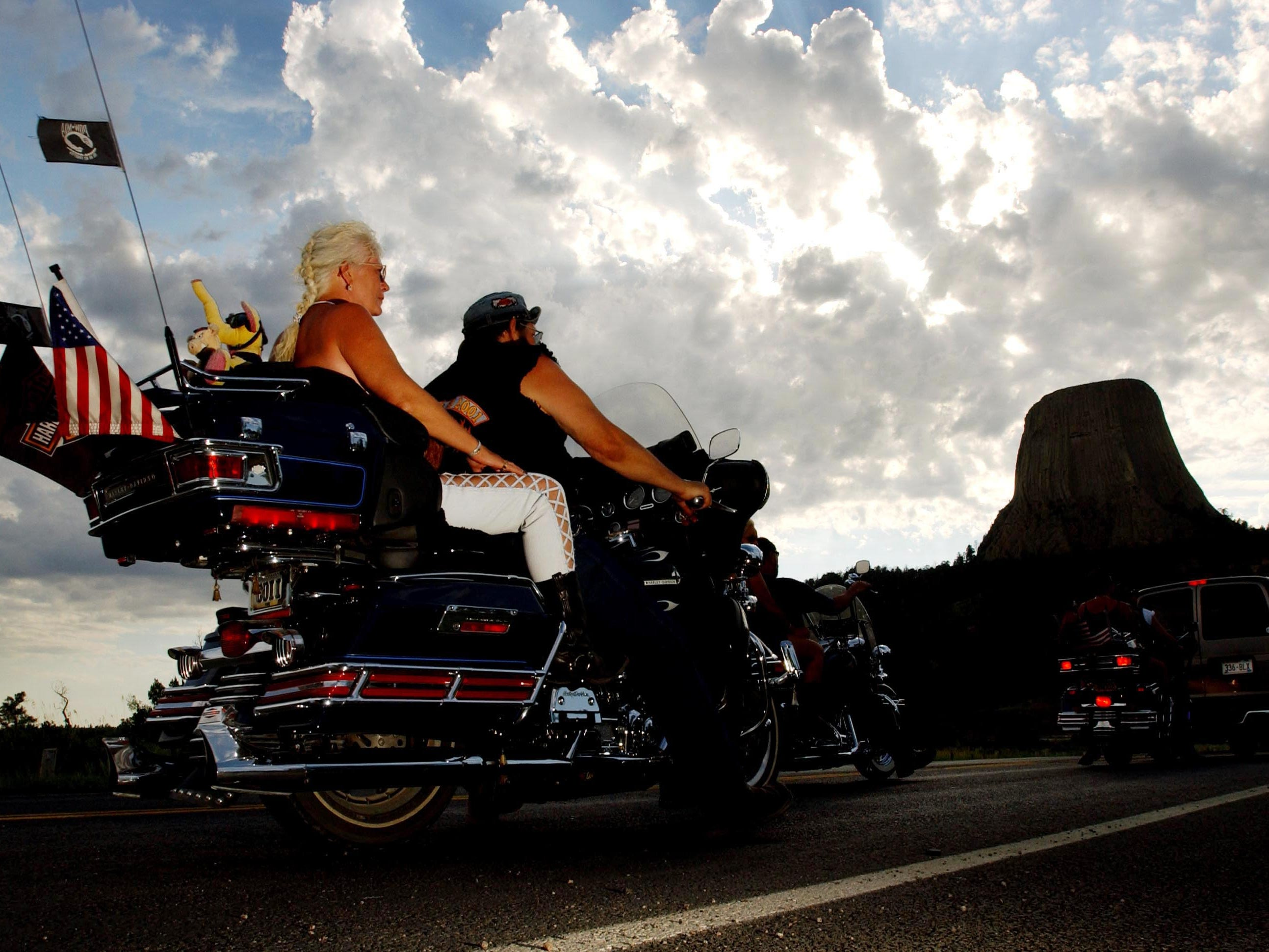 2001: Motorcylists pass Devils Tower National Monument in Wyoming, which is one of many popular destinations for cyclists attending the annual Sturgis Motorcycle Rally in Sturgis, SD.