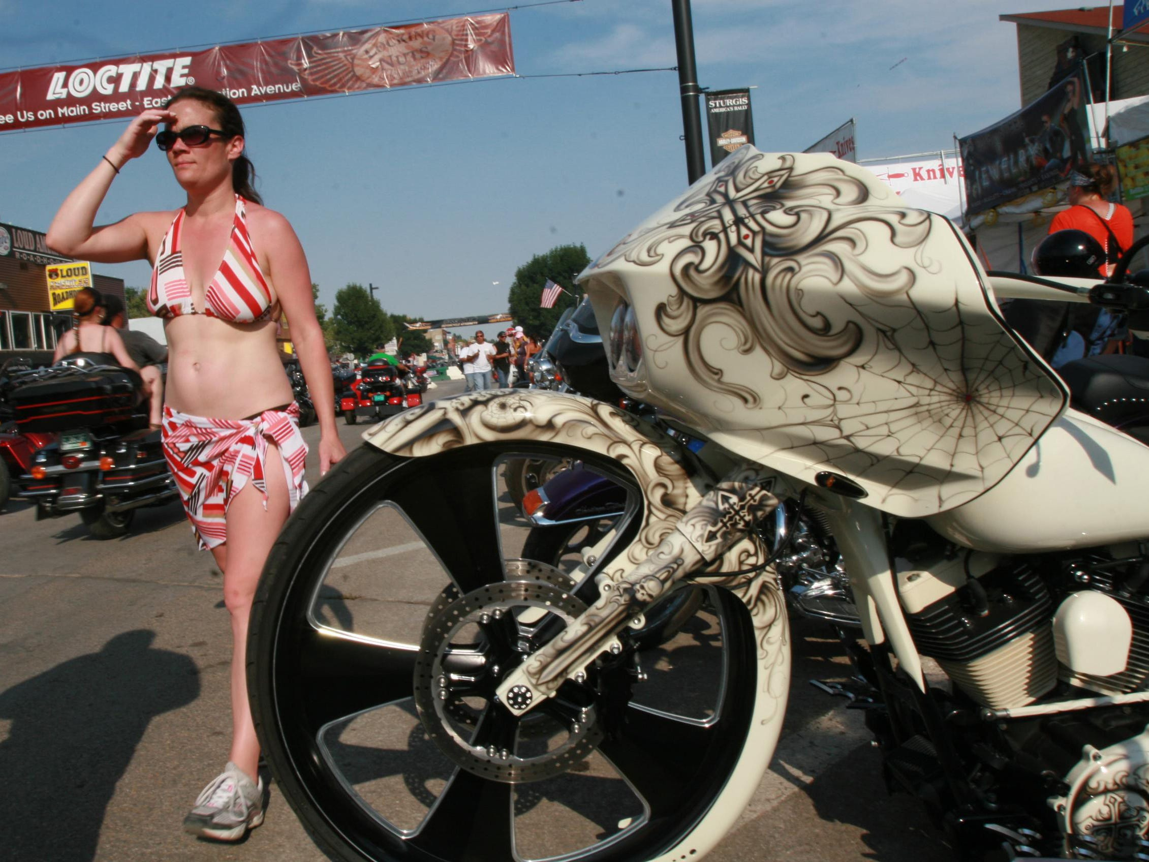 2012: Elaborate paint jobs on motorcyles and people watching are favorite activities at the annual bike week.