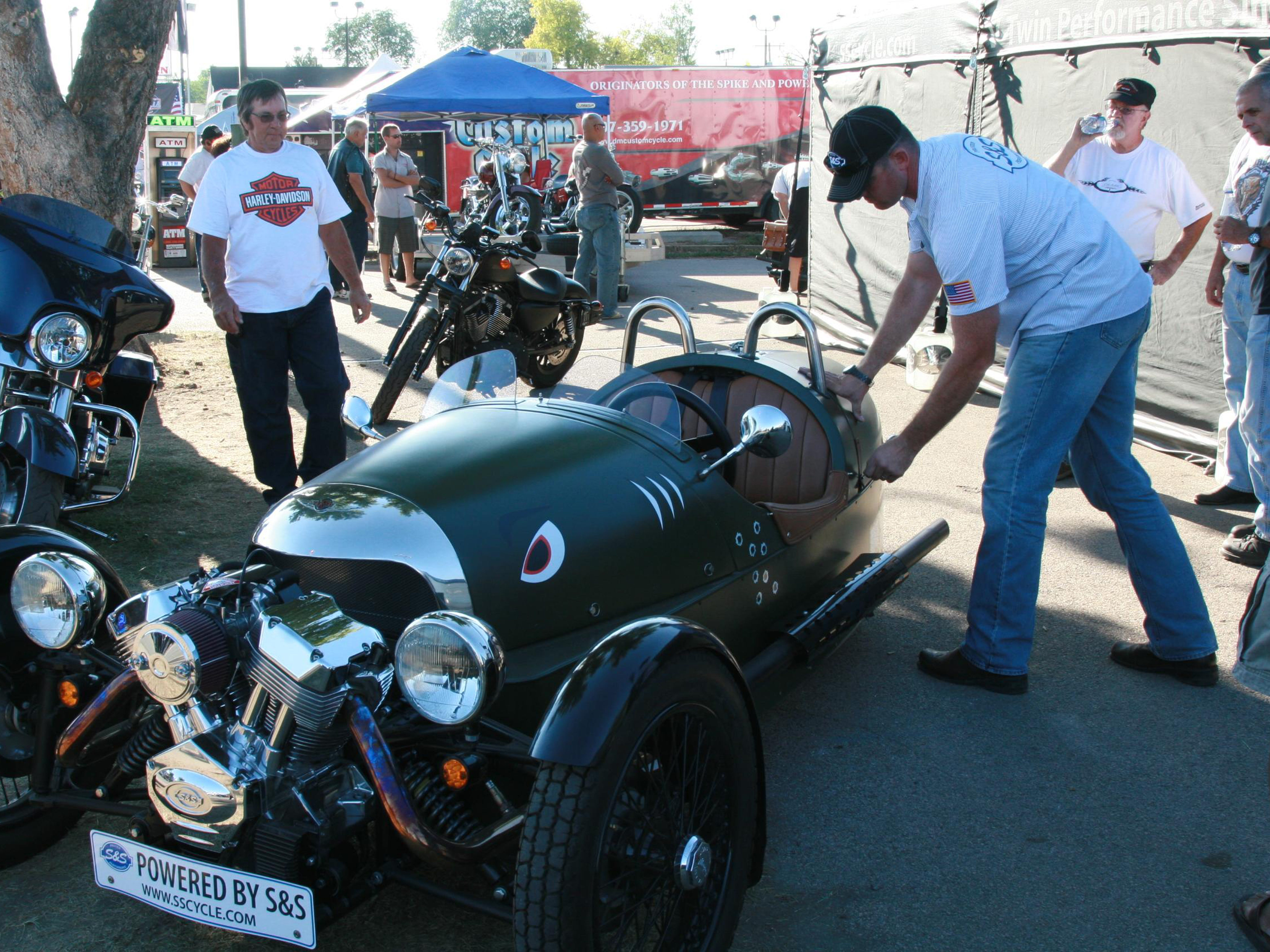 2012: Shane Whittey, with S&S Cycles of Viola, works on a Morgan sports car that has an S&S engine in it. The three-wheel car/motorcycle hybrid had been on display at the Sturgis Motorcycle Rally in Sturgis, S.D.
