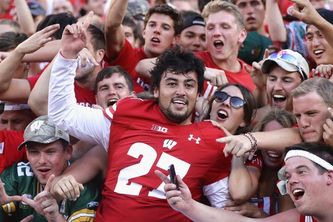 GREEN BAY, WI - SEPTEMBER 03:  Rafael Gaglianone #27 of the Wisconsin Badgers celebrates with fans after defeating the LSU Tigers 16-14 at Lambeau Field on September 3, 2016 in Green Bay, Wisconsin.  (Photo by Jonathan Daniel/Getty Images)