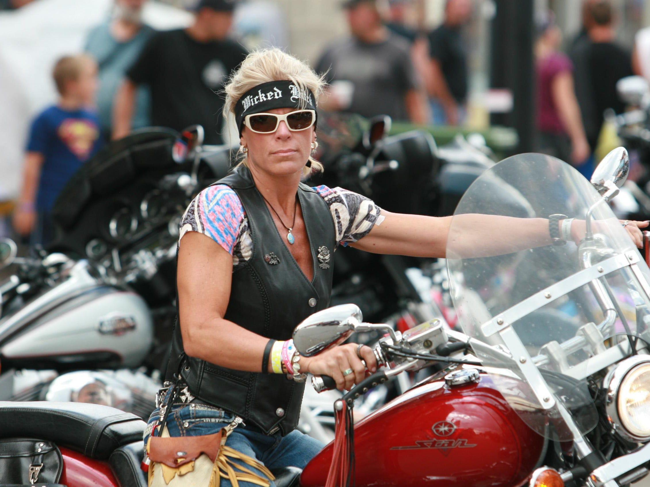 2012: Brenda Clark of Minneapolis rides on Lazelle Street in Sturgis.