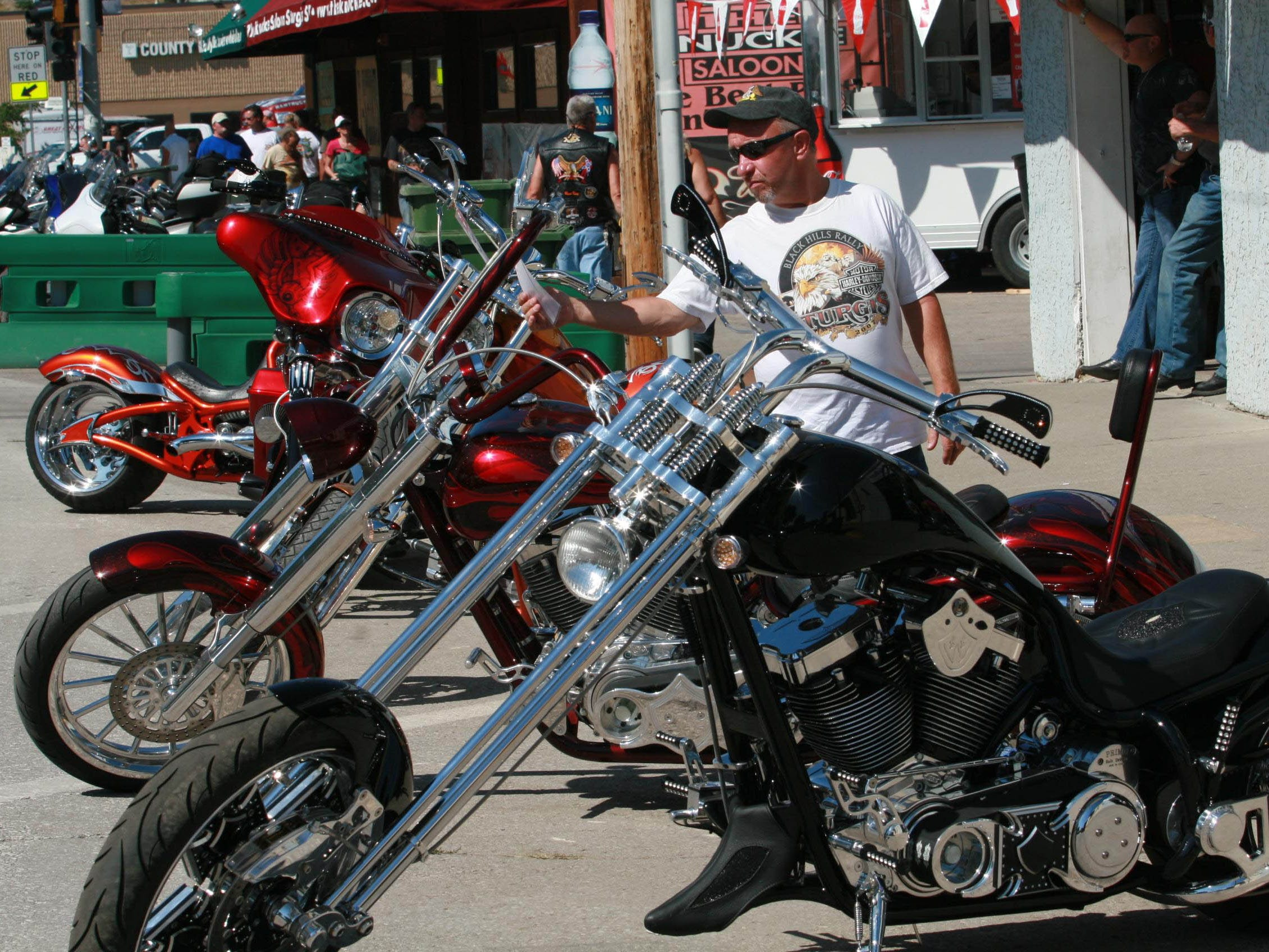 2012: Rally-goers check out custom bikes at the AMD World Championship of Bike Building.