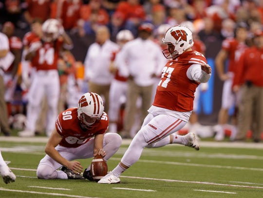 Rafael Gaglianone converts a 28-yard field goal out of the hold of Connor Allen during the Big Ten title game last season against Ohio State.