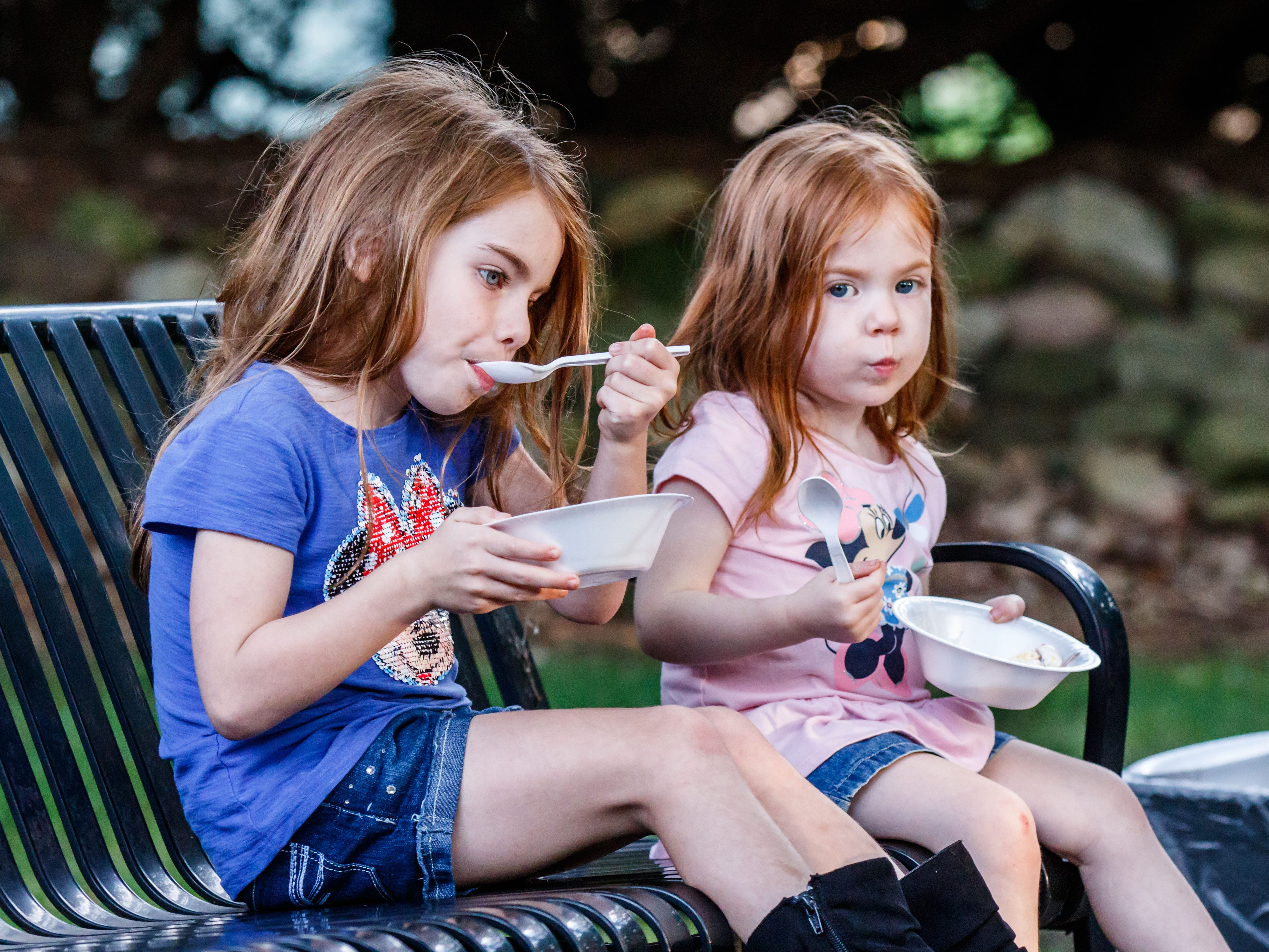 Five-year-old Riley Ebbole and her sister Bailey, 2, of Brookfield, enjoy ice cream sundaes during the Brookfield Public Library's Ice Cream Social on Tuesday, August 7, 2018. The free event, sponsored by Friends of the Library, celebrates the end of Summer Reading with ice cream and music.