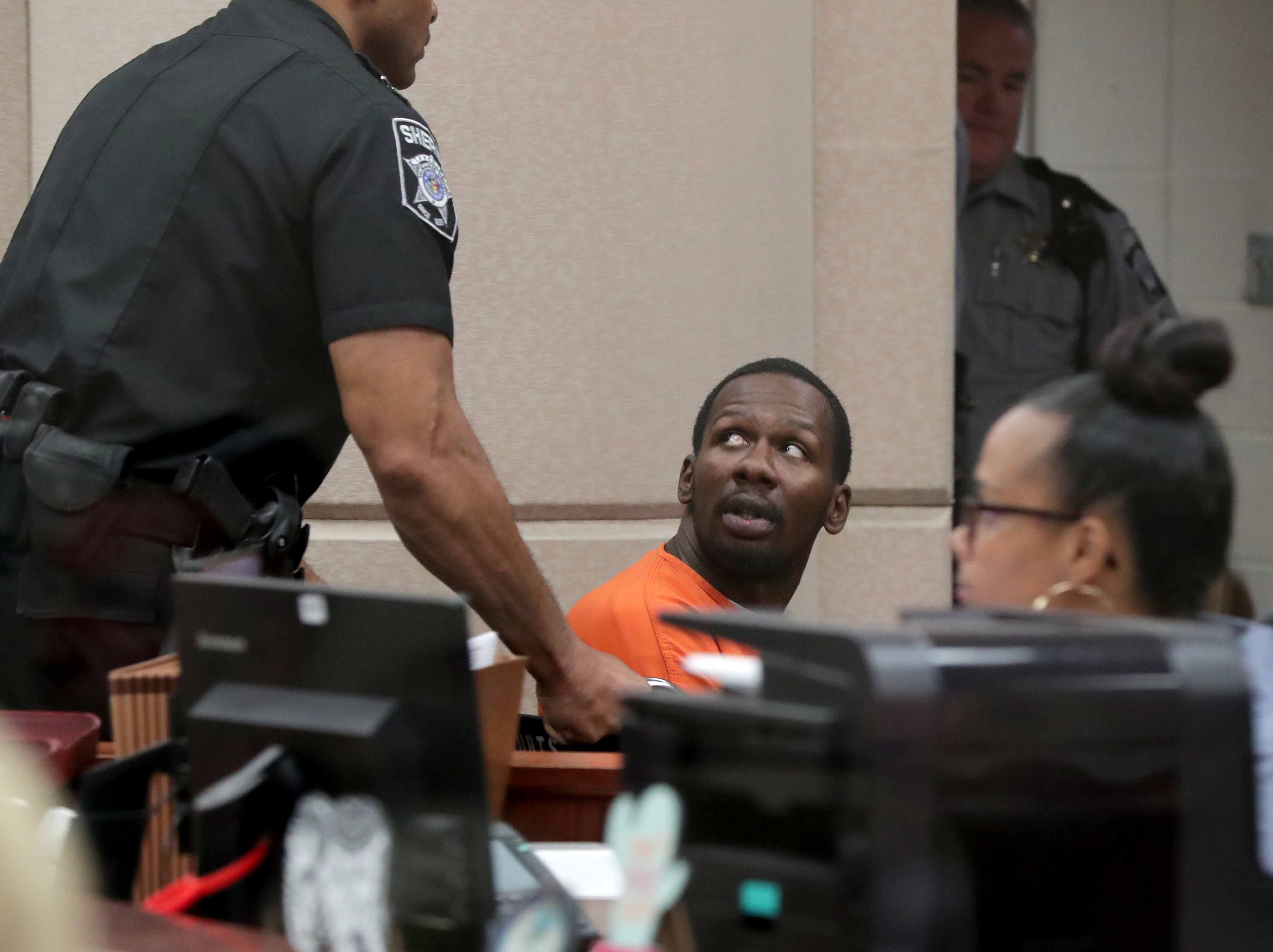 Jonathan Copeland Jr., 30, who is charged in the fatal shooting of Milwaukee Police Officer Michael Michalski, is taken out of court after he appeared  on Thursday.