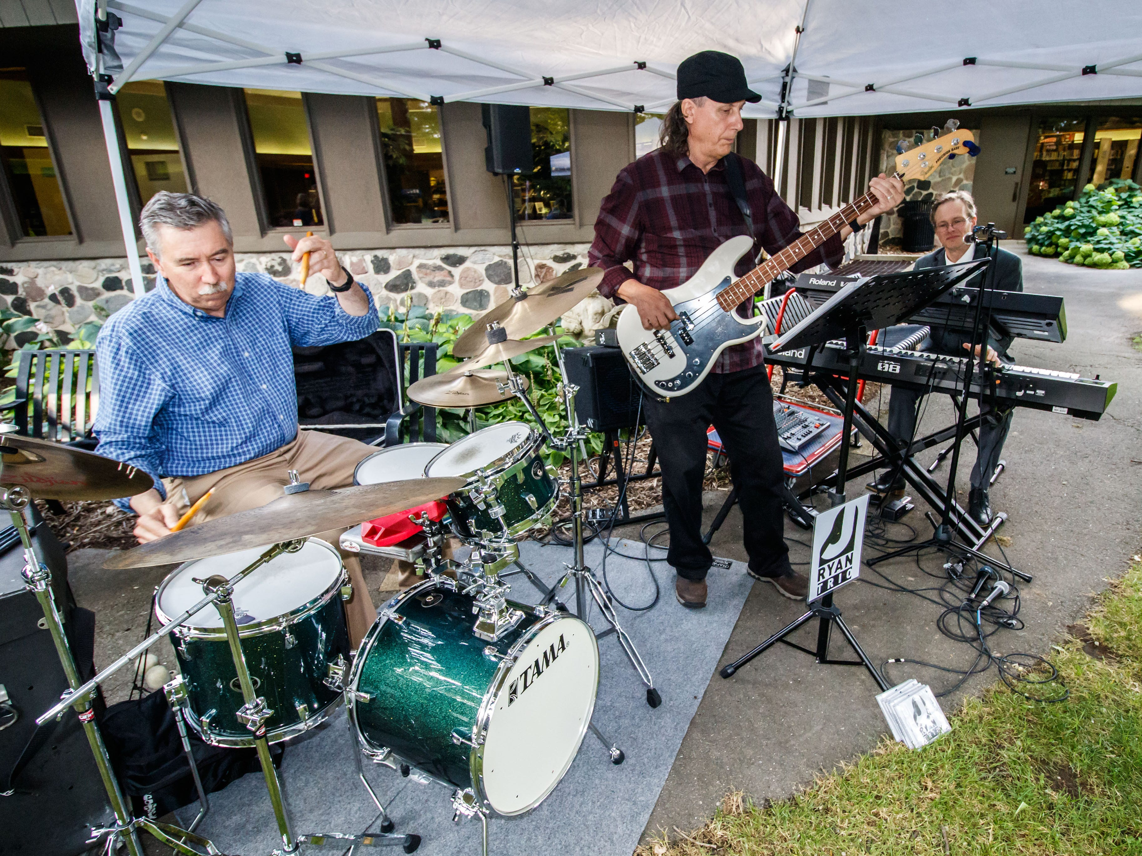 The J Ryan Trio entertains visitors with jazz standards and down home blues during the Brookfield Public Library's Ice Cream Social on Tuesday, August 7, 2018. The free event, sponsored by Friends of the Library, celebrates the end of Summer Reading with ice cream and music.