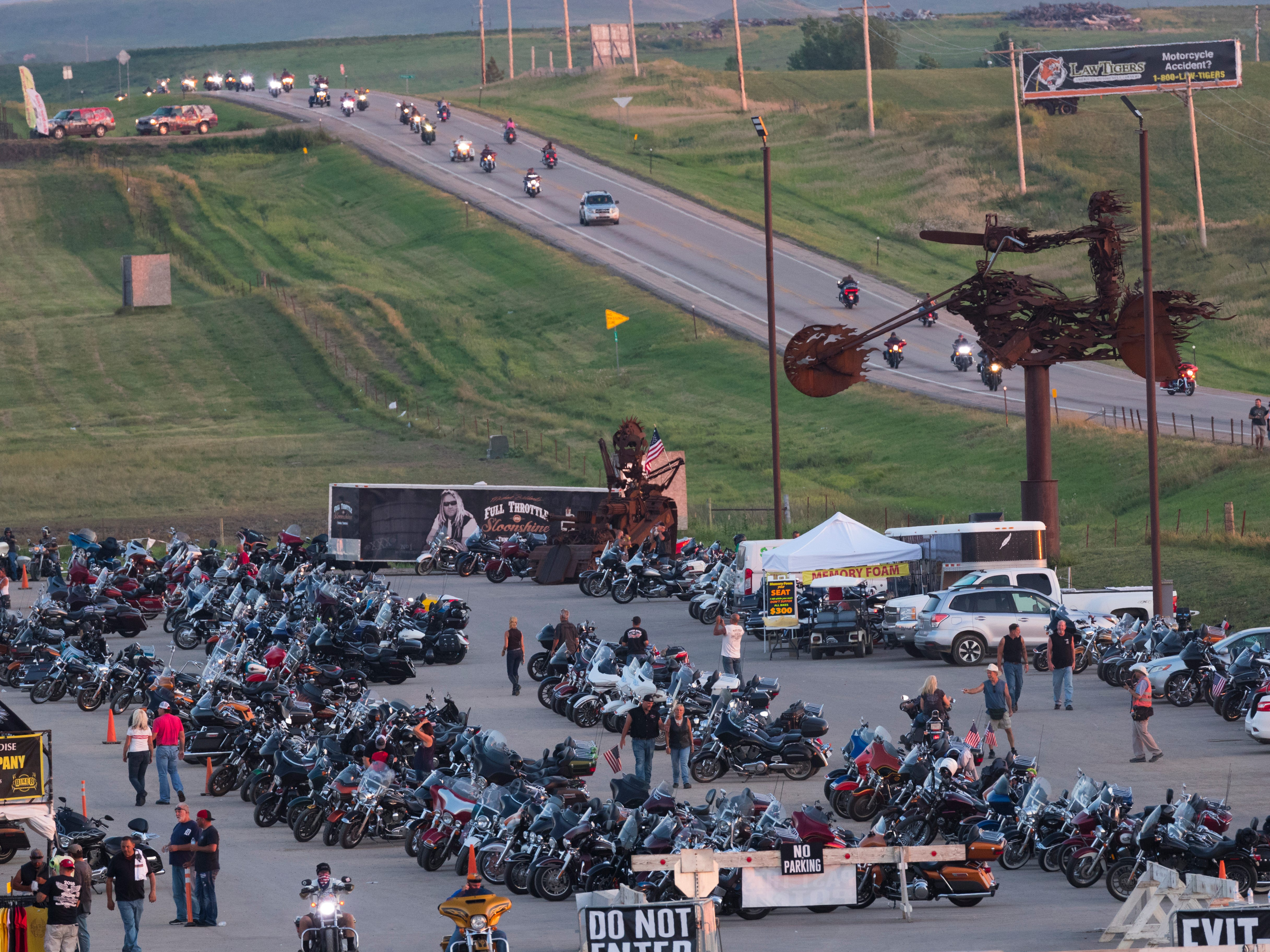 Motorcyclists coming from Sturgis file into the Full Throttle Saloon.