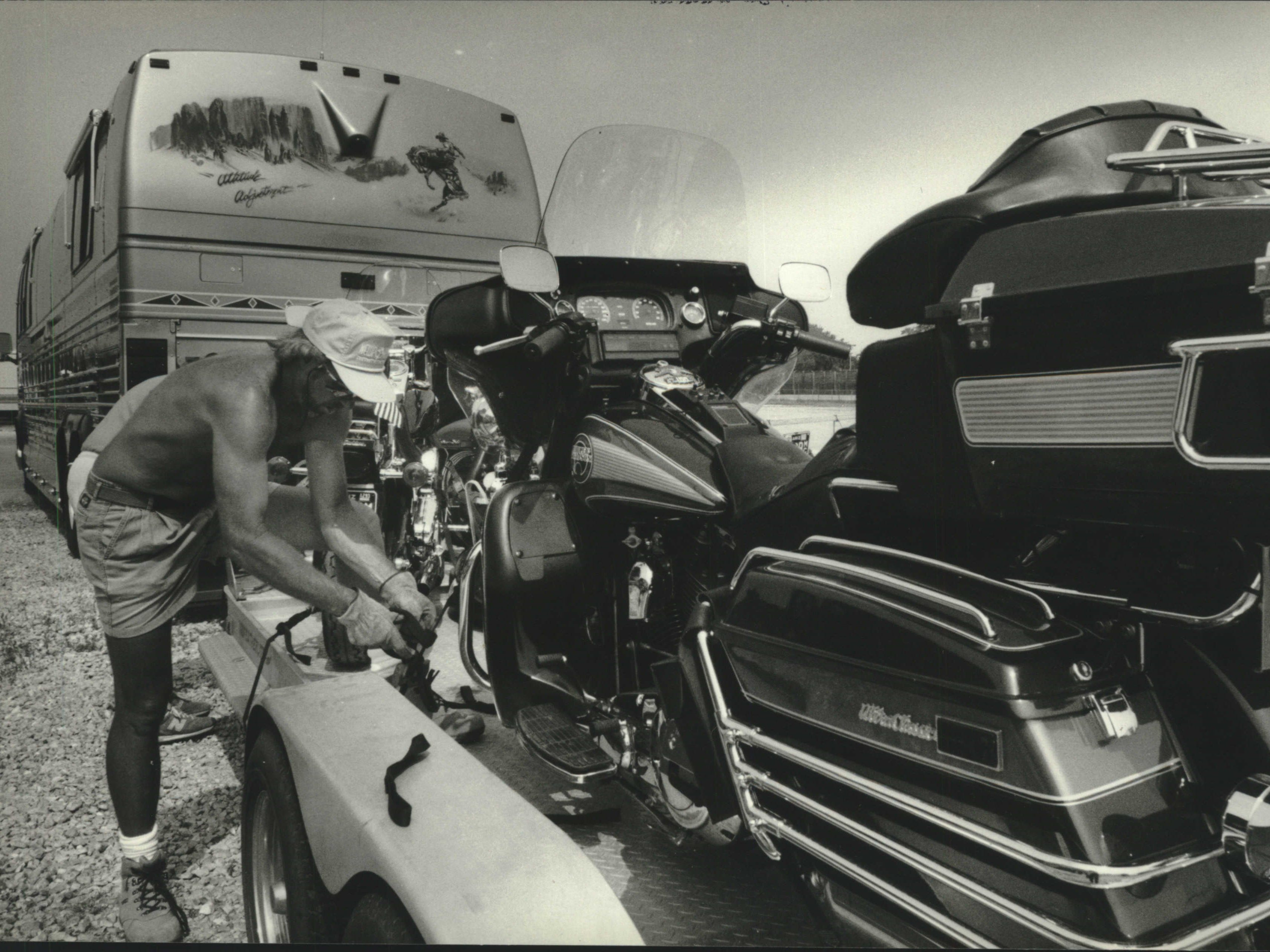 1993: After Harley-Davidson's 90th anniversary parade and celebration, Sam Ragland of Lake Havasu City, Arizona, packs up at State Fair Park to head for another motorcycle rally at Sturgis, S.D.