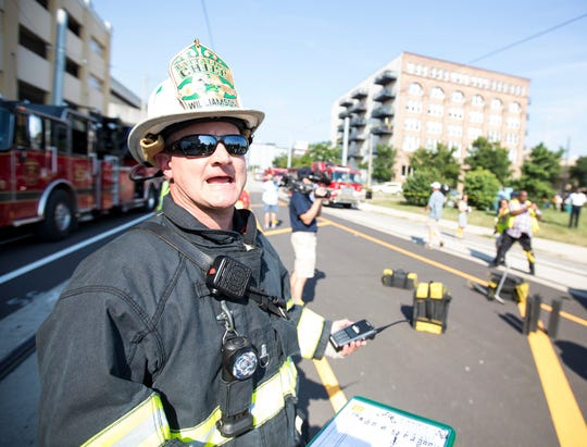 Milwaukee Fire Department Battalion Chief Matt Williamson instructs firefighters during the exercise.