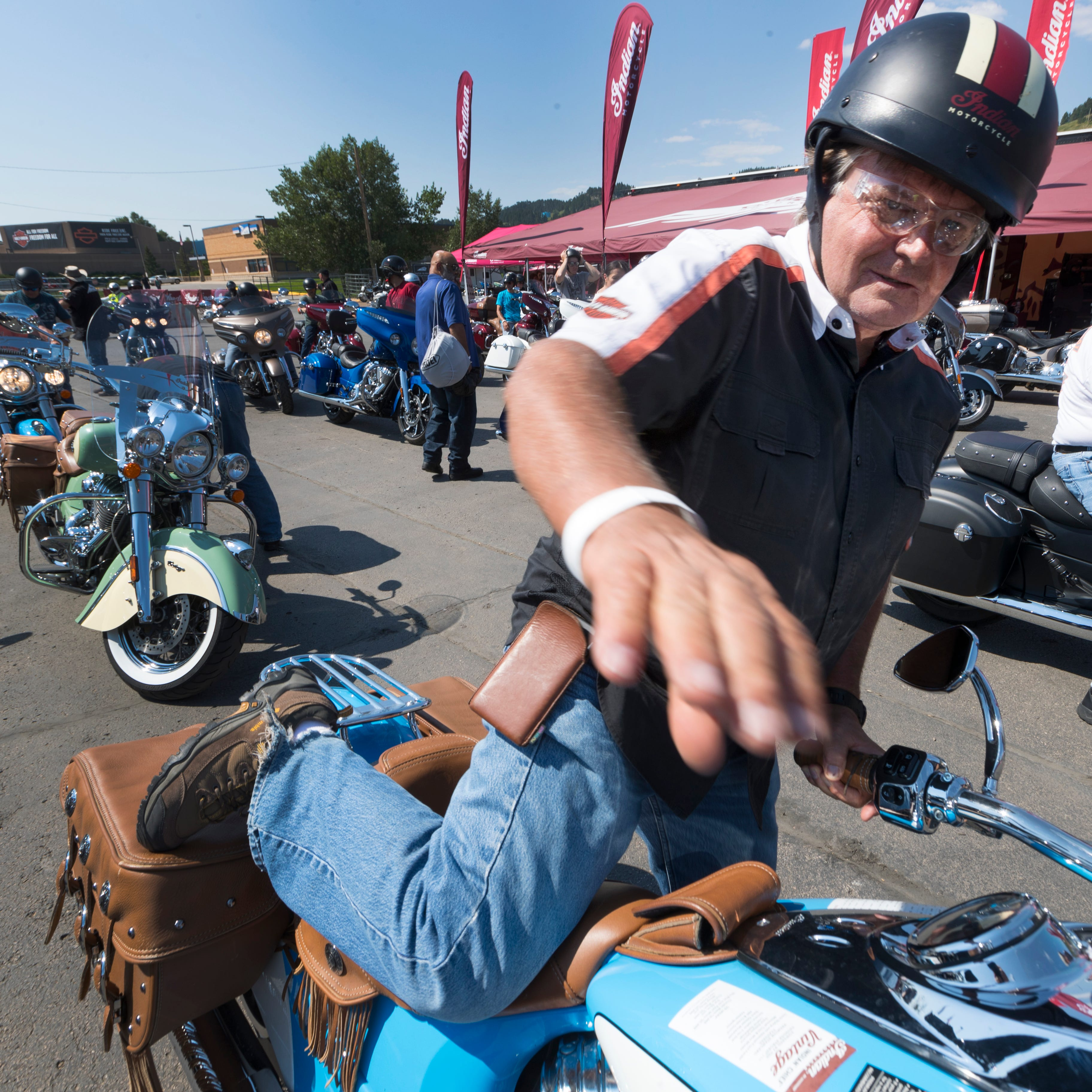 Roger Fridal of  Tremonton, Utah, mounts an Indian Motorcycle's demonstrator. An owner of a pair of Harley-Davidsons, he was impressed by the Indians and said he believes competition is good for the market.